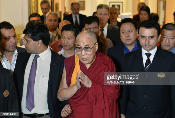 Tibetan spiritual leader and Nobel peace prize winner the Dalai Lama arrives to inaugurate a 'Peace for Economy' conference in Bangalore on December...