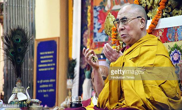 Tibetan spiritual leader Dalai Lama takes part in prayers at the Tsuglagkhang temple on July 20 2015 in Dharamsala India Eleven Tibetan NGOs based in...