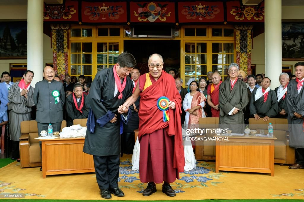 Tibetan spiritual leader His Holiness the Dalai Lama (R) and the re-elected Sikyong (Prime Minister of the Central Tibetan Administration Lobsang Sangay pose for a photograph after Sangay's swearing-in ceremony at the Tsuglakhang Temple in McLeod Ganj on May 27, 2016. The Dalai Lama warned May 27 of a growing divide among exiled Tibetans, saying that morals are 'degenerating' in the community, as the leader of its government-in-exile was sworn in at a ceremony in India. / AFP / Lobsang Wangyal