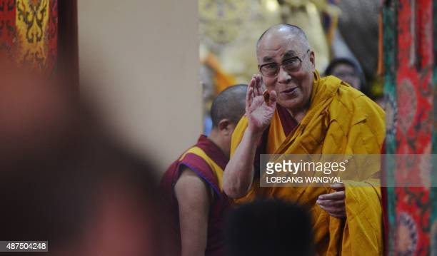 Tibetan spiritual leader His Holiness the Dalai Lama greets followers before starting lectures on Buddhist philosophy at the Tsuglakhang Temple in...