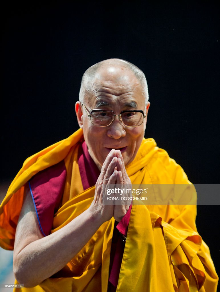 Tibetan spiritual leader in exile Tenzin Gyatso, the 14th Dalai Lama, gestures during the Programme of Buddhist Teachings in Mexico City, on October 12, 2011. The Dalai Lama is on a six-day visit to Mexico. AFP PHOTO/RONALDO SCHEMIDT