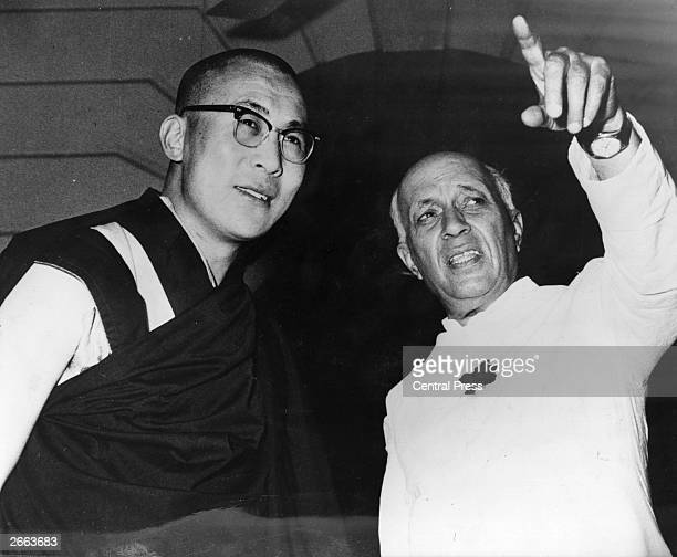 Tibetan spiritual leader the Dalai Lama and Indian Prime Minister Jawaharlal Nehru in New Delhi where they are meeting to discuss the rehabilitation...