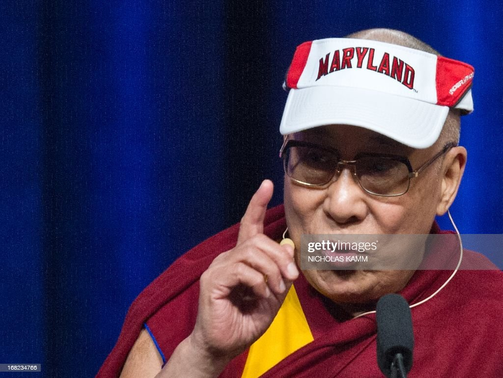 Tibetan spiritual leader the Dalai Lama delivers the Sadat Lecture for Peace, entitled 'Peace Through Compassion: Connecting a Multi-Faith World,' at the University of Maryland in College Park, Maryland, on May 7, 2013. AFP PHOTO/Nicholas KAMM