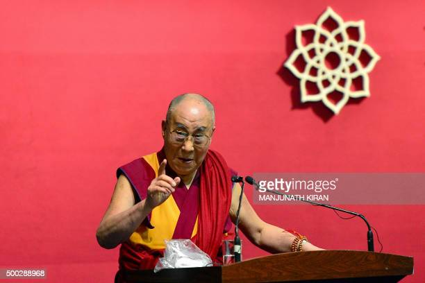 Tibetan spiritual leader The Dalai Lama gestures as he addresses the gathering during the foundation stone laying ceremony of the Nimhans Integrated...
