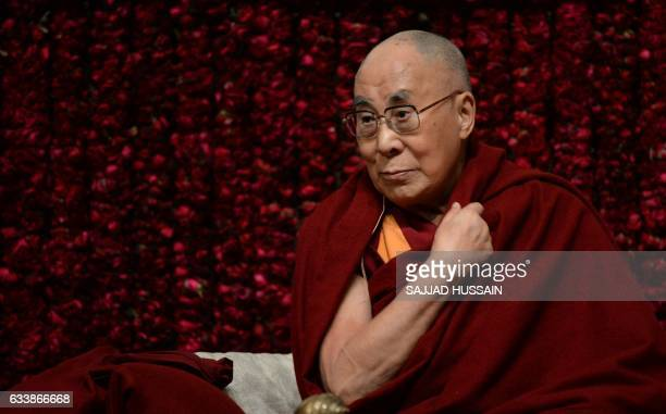 Tibetan spiritual leader the Dalai Lama gestures before delivering a public lecture on Reviving Indian Wisdom in Contemporary India at a function in...
