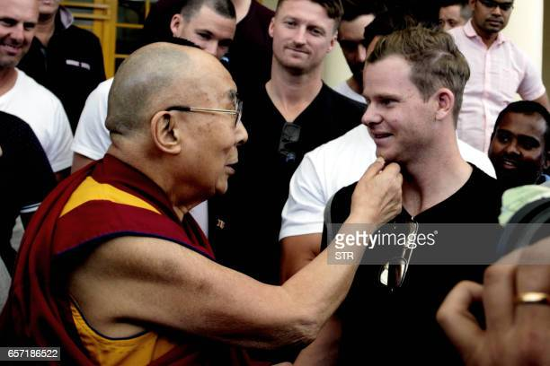Tibetan Spiritual Leader The Dalai Lama greets Australian touring cricket captain Steve Smith at his residence in Dharamsala on March 24 ahead of the...