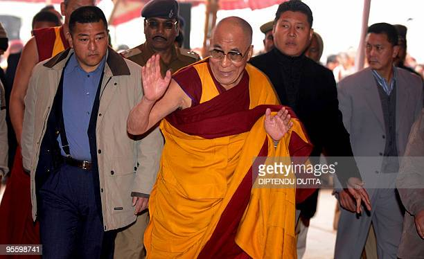 Tibetan spiritual leader The Dalai Lama greets devotees during the second day of a teaching session at Kalachakra Ground near the historical...