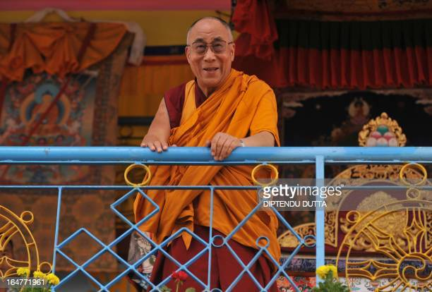 Tibetan spiritual leader the Dalai Lama greets his followers ahead of a preaching session at the Buddhist cultural school in Salugara on the...
