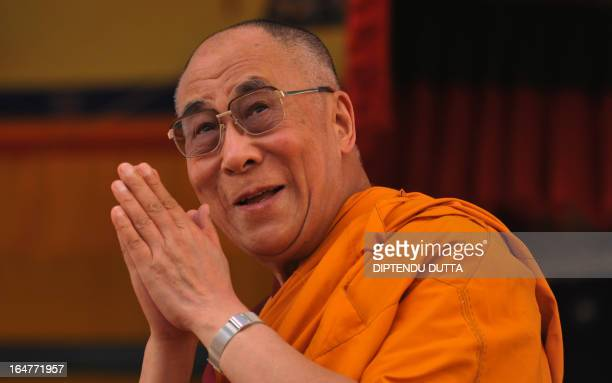Tibetan spiritual leader the Dalai Lama greets his followers at the Buddhist cultural school in Salugara on the outskirts of Siliguri on March 28...