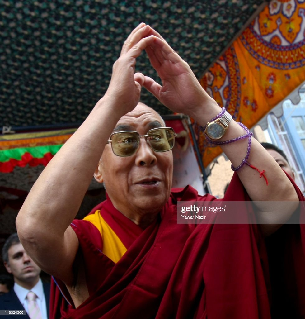 Tibetan spiritual leader the Dalai Lama greets people during his visit to a Tibetan school on July 14, 2012 in Srinagar the summer capital of Indian administered Kashmir, Indian. The Dalai Lama is in Kashmir for about a week to visit the Tibetan community living in the predominately Muslim area.