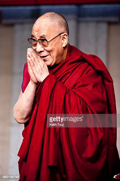 Tibetan spiritual leader the Dalai Lama is introduced to guests during 'Dialogue in Tokyo' at Hotel Okura on November 17 2013 in Tokyo Japan The...
