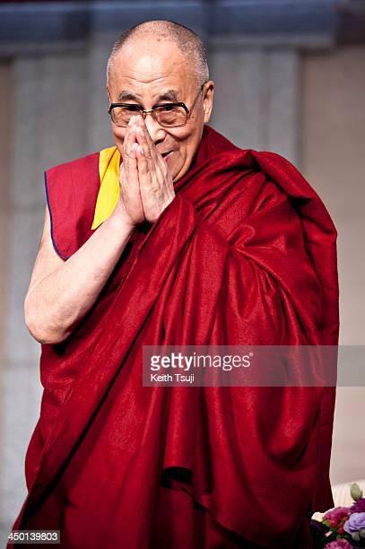 Tibetan spiritual leader the Dalai Lama is introduced to guests during 'Dialogue in Tokyo' at Hotel Okura on November 17 2013 in Tokyo Japan The...