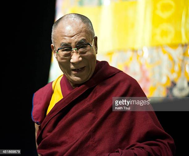 Tibetan spiritual leader the Dalai Lama is introduced to guests during the Conversations with His Holiness the Dalai Lama at Ryogoku Kokugikan on...