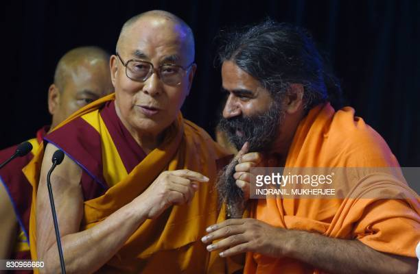 Tibetan spiritual leader The Dalai Lama jokingly pulls Indian yoga guru Baba Ramdev's beard during a inter faith religious conclave ahead of India's...