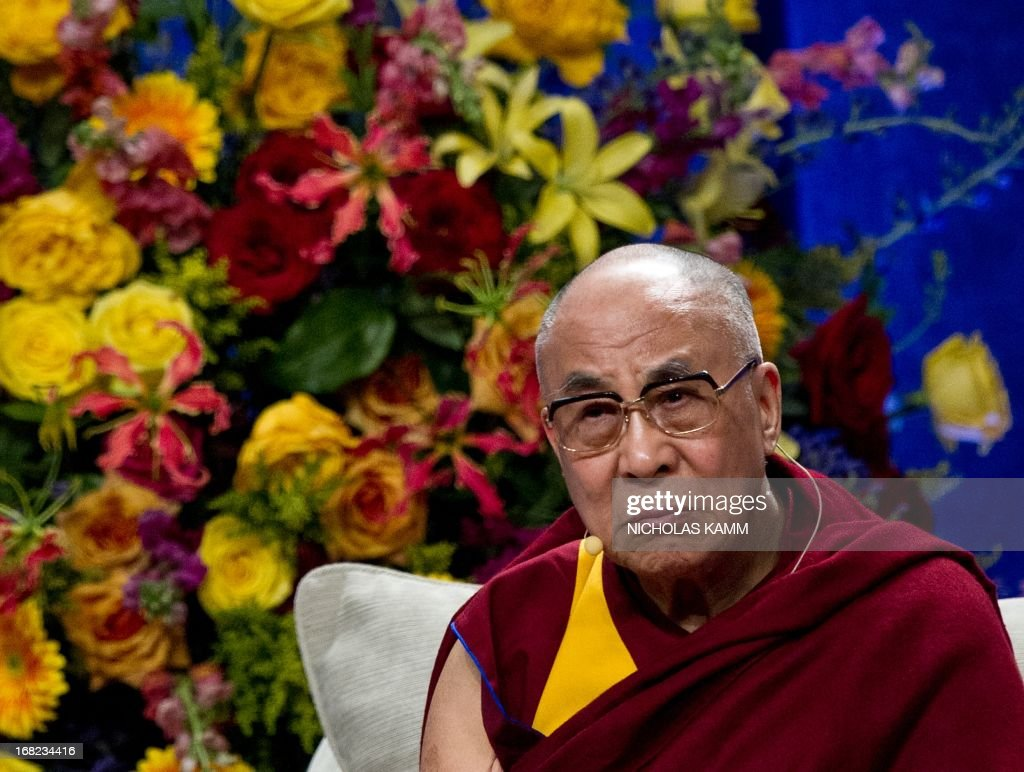 Tibetan spiritual leader the Dalai Lama listens to speakers before delivering the Sadat Lecture for Peace, entitled 'Peace Through Compassion: Connecting a Multi-Faith World,' at the University of Maryland in College Park, Maryland, on May 7, 2013. AFP PHOTO/Nicholas KAMM