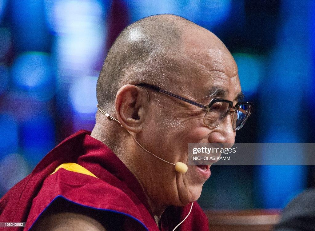 Tibetan spiritual leader the Dalai Lama looks on before delivering the Sadat Lecture for Peace, entitled 'Peace Through Compassion: Connecting a Multi-Faith World,' at the University of Maryland in College Park, Maryland, on May 7, 2013. AFP PHOTO/Nicholas KAMM