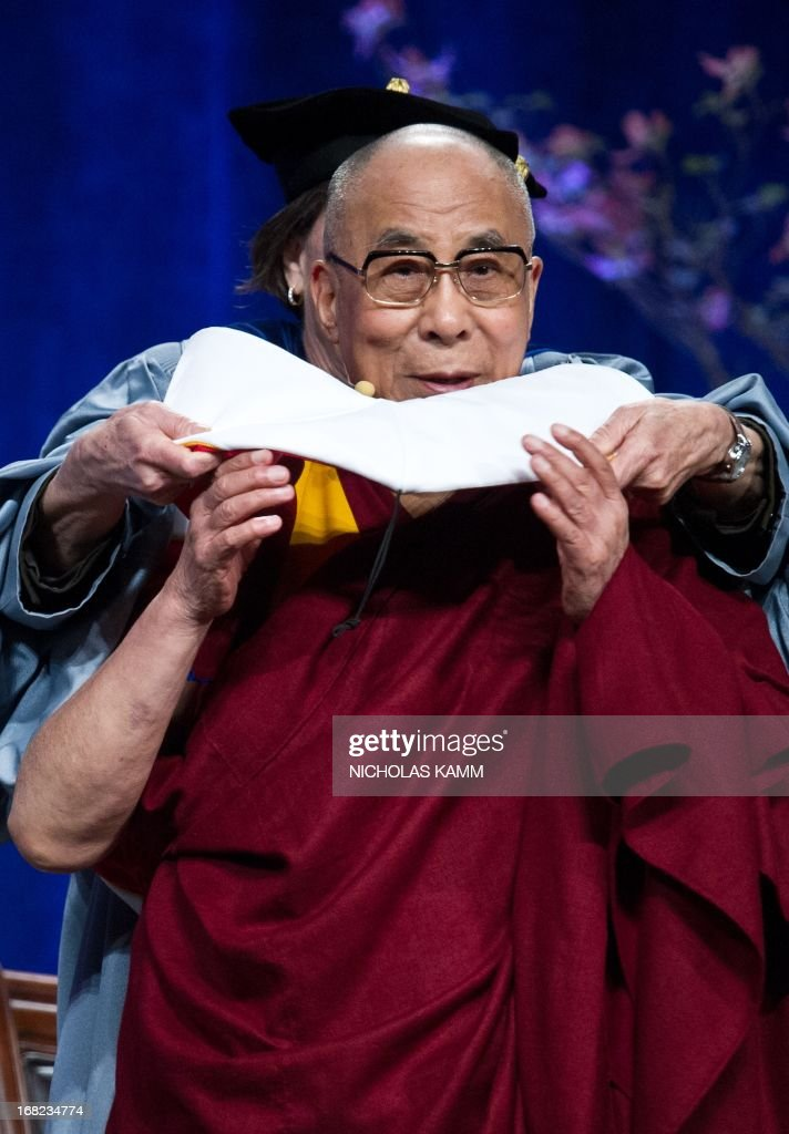 Tibetan spiritual leader the Dalai Lama receives an honorary doctorate after delivering the Sadat Lecture for Peace, entitled 'Peace Through Compassion: Connecting a Multi-Faith World,' at the University of Maryland in College Park, Maryland, on May 7, 2013. AFP PHOTO/Nicholas KAMM