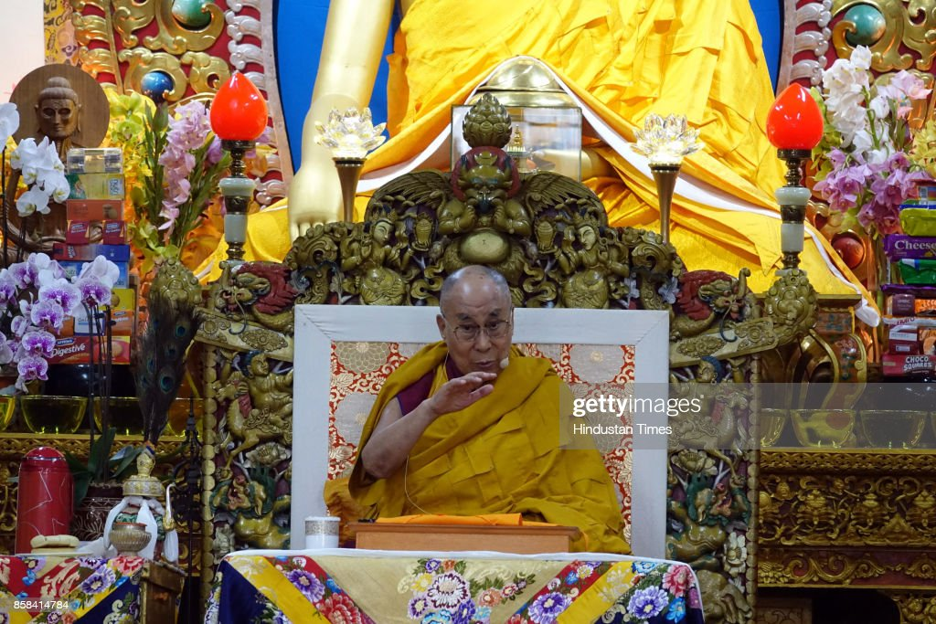 Tibetan spiritual leader the Dalai Lama sits on his ceremonial chair as he prays before beginning a religious talk at the Tsuglakhang Temple on October 6, 2017 in Dharamsala, India.