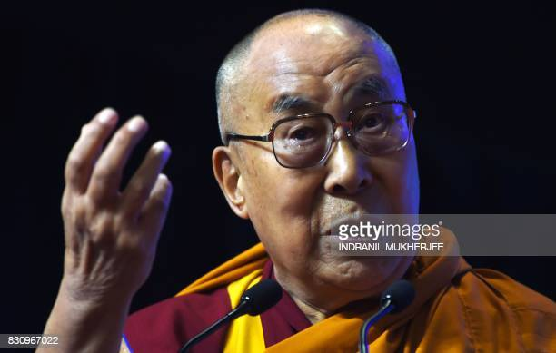 Tibetan spiritual leader The Dalai Lama speaks during a inter faith religious conclave ahead of India's 70th anniversary of Independence in Mumbai on...