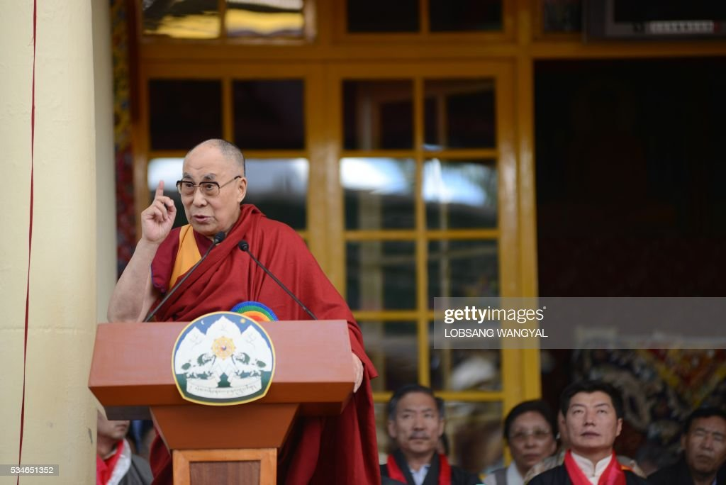 Tibetan Spiritual leader the Dalai Lama speaks during the swearing-in ceremony of re-elected Sikyong (Prime Minister of the Central Tibetan Administration) Lobsang Sangay at the Tsuglakhang Temple in McLeod Ganj on May 27, 2016. The Dalai Lama warned May 27 of a growing divide among exiled Tibetans, saying that morals are 'degenerating' in the community, as the leader of its government-in-exile was sworn in at a ceremony in India. / AFP / Lobsang Wangyal