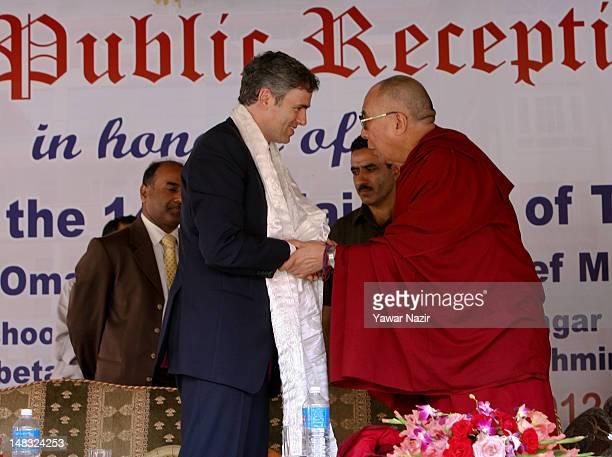 Tibetan spiritual leader the Dalai Lama wraps a 'Khatka' or a traditional ceremonial Tibetan Scarf around the neck of Omar Abdullah chief minister of...
