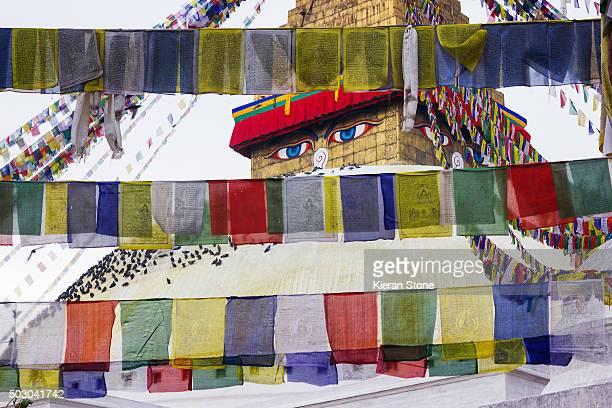 Tibetan temple behind prayer flags