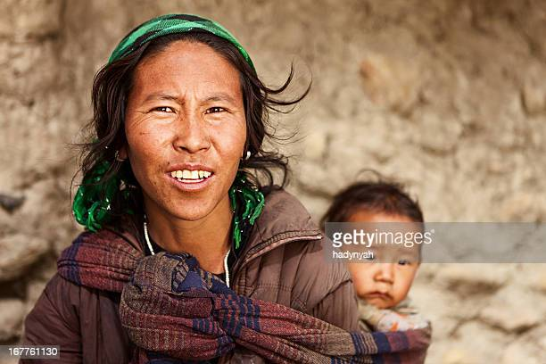 Tibetan woman carrying her baby, Mustang, Nepal