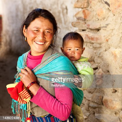 Tibetan woman carrying her baby : Stock Photo