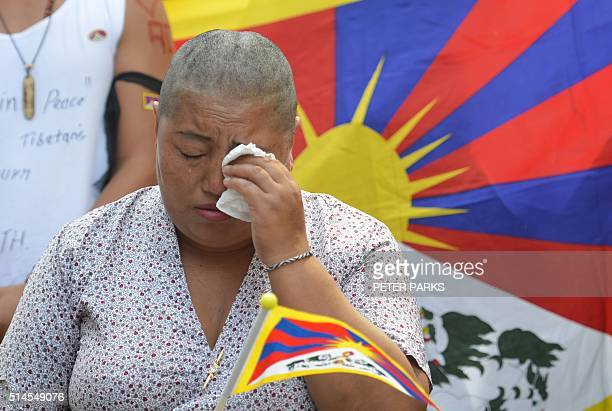 A Tibetan woman cries after having her head shaved during a rally to mark the 57th Tibetan National Uprising Day at Martin Place in Sydney on March...