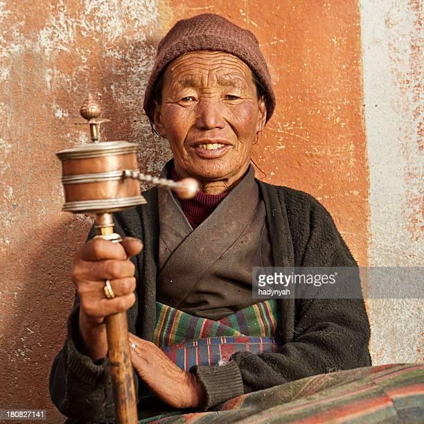 Tibetan woman praying, Mustang