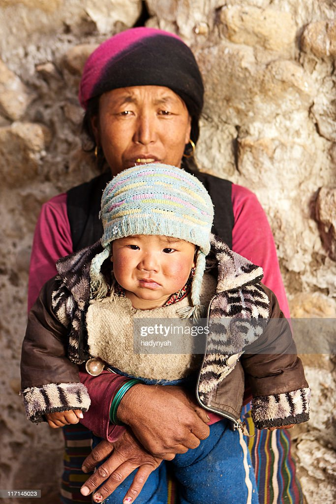 Tibetan woman with her baby