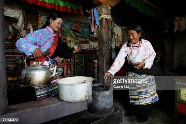 Tibetan women makes milk tea for a guest at their home in a small village in the district of Naqu July 7 2006 in Lhasa Tibetan Autonomous Region...