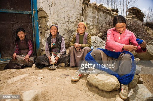 Tibetan women spinning wool in Mustang region
