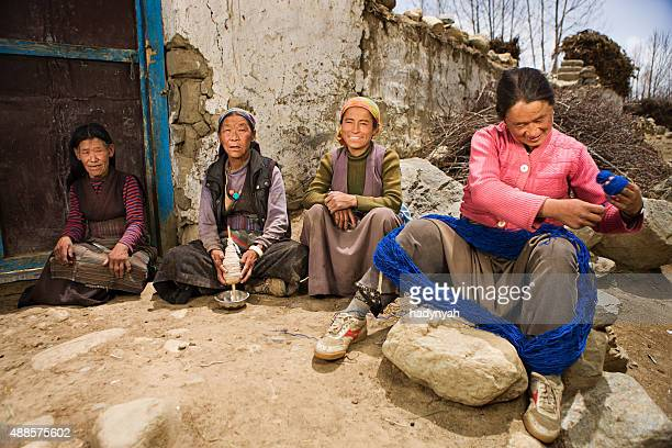 Tibetan women spinning wool in Mustang region