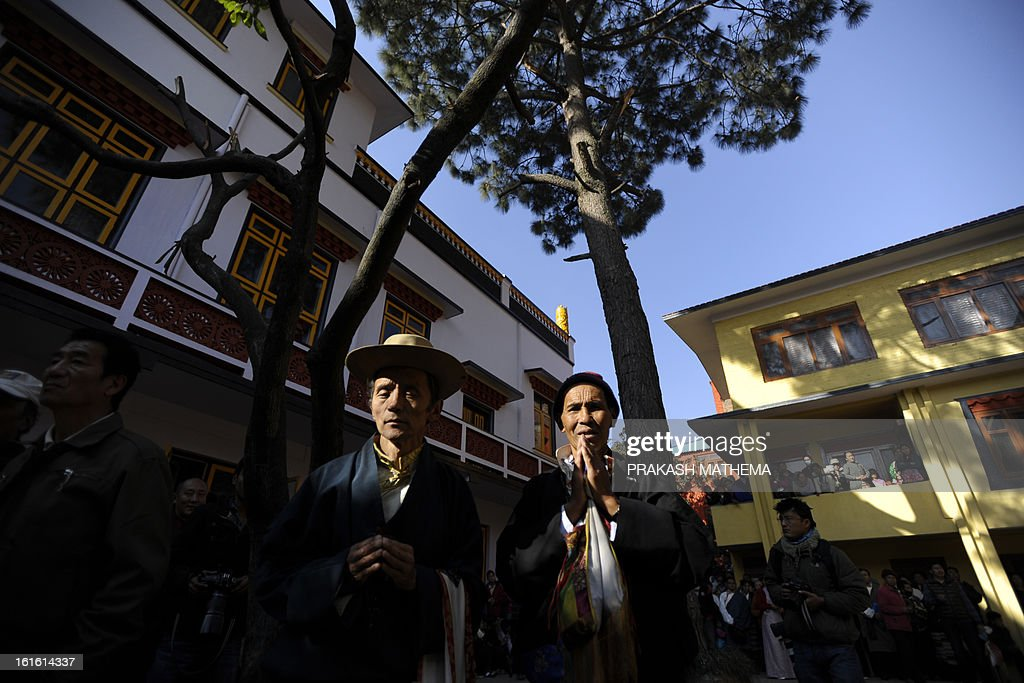 Tibetans in exile observe the third day of Losar, the Tibetan new year, in Kathmandu on February 13, 2013. A Tibetan monk doused himself in petrol in a Kathmandu restaurant on Wednesday and set himself on fire, marking the 100th self-immolation bid in a wave of protests against Chinese rule since 2009. AFP PHOTO/Prakash MATHEMA