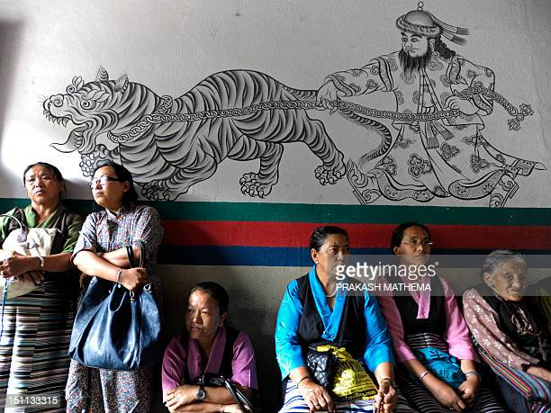 Tibetans inexile attend a ceremony marking the 52nd Tibetan Democracy Day at the Boudha in Kathmandu on September 2 2012 Tibetan Democracy Day marks...