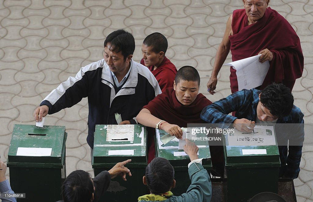 Tibetans inexile cast their votes for the Tibetan Parliamentary election at a polling station in Dharamshala on March 20 2011 Thousands of Tibetans...
