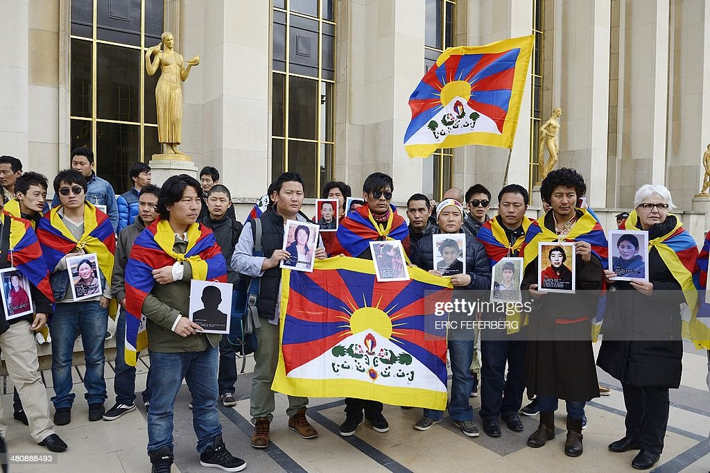 Tibetans living abroad hold Tibetan flags as they demonstrate in Paris against the the visit of the Chinese President and other Chinese dignitaries...