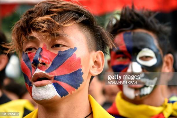 Tibetans living in exile stage a demonstration during the 58th Anniversary of the Tibetan National uprising day in Bangalore on March 10 2017 / AFP...