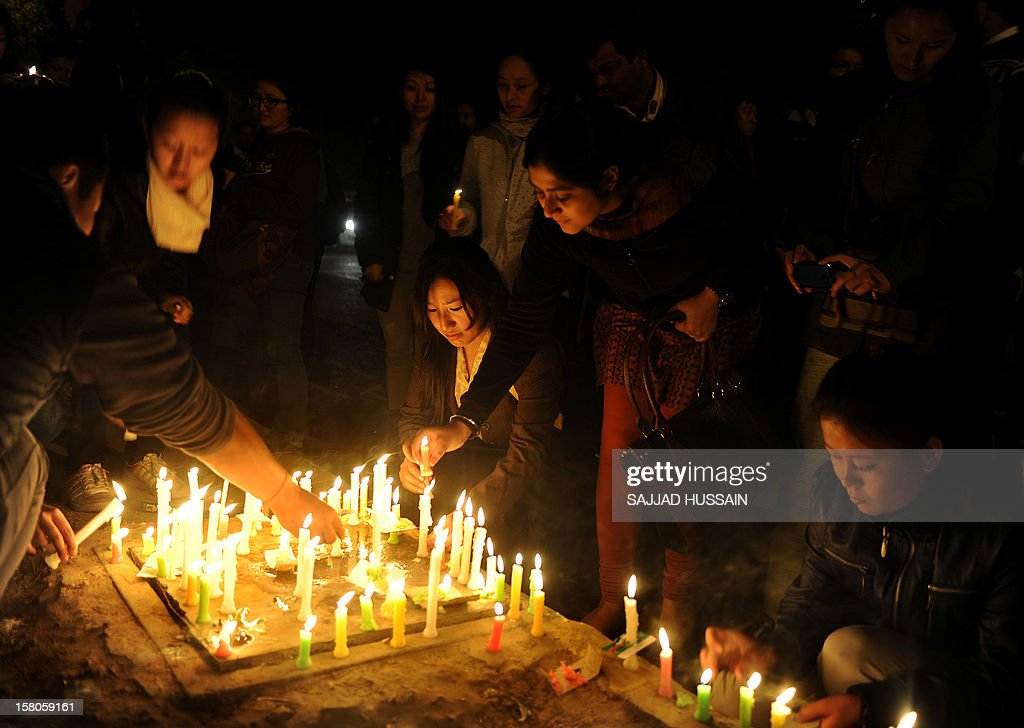 Tibetans living in-exile light candles as they take part in a candle light march in New Delhi on December 10, 2012 to mark World Human Rights Day. A 16-year-old Tibetan girl has died after setting herself on fire, Chinese state media said December 10, in an area that has become a flashpoint for protests against Beijing's rule. AFP PHOTO/SAJJAD HUSSAIN