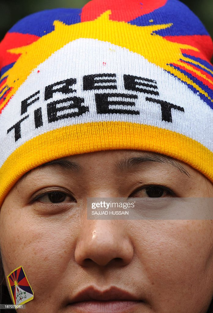 A Tibetans living-in-exile looks on during a 'Tibet Solidarity Campaign' protest in New Delhi on November 6, 2013. Tensions between Tibetans and the Chinese government continue to run high, with more than 120 members of the minority setting themselves on fire in protest in recent years.