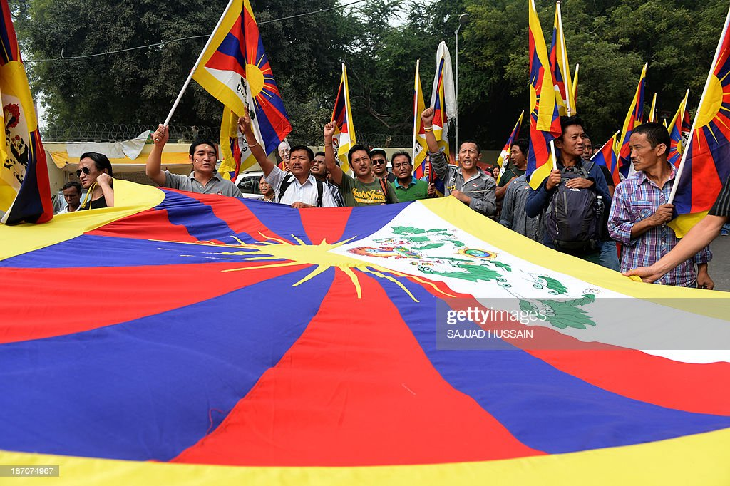 Tibetans living-in-exile shout slogans during a 'Tibet Solidarity Campaign' protest in New Delhi on November 6, 2013. Tensions between Tibetans and the Chinese government continue to run high, with more than 120 members of the minority setting themselves on fire in protest in recent years. AFP PHOTO/ SAJJAD HUSSAIN