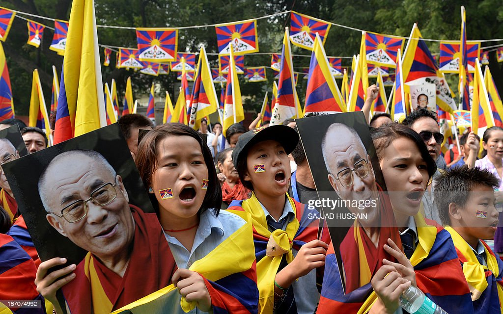 Tibetans living-in-exile shout slogans during a 'Tibet Solidarity Campaign' protest in New Delhi on November 6, 2013. Tensions between Tibetans and the Chinese government continue to run high, with more than 120 members of the minority setting themselves on fire in protest in recent years.