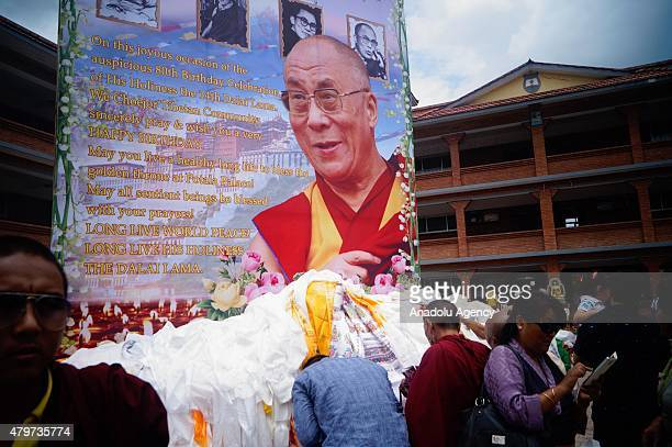 Tibetans offers prayer in front of the portrait of their spiritual leader 14th Dalai Lama during his 80th birthday celebration in Kathmandu July 6...