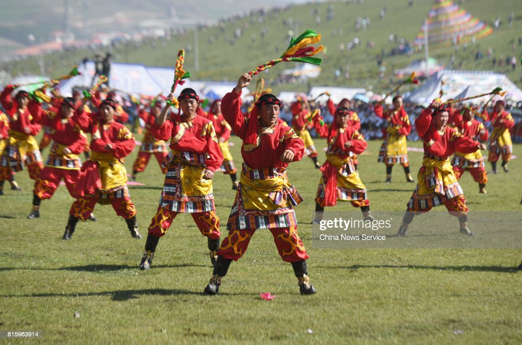 Tibetans perform during The 18th China nine color Gannan the Shambhala Tourism Arts Festival at Hezuo on July 17, in Gannan Tibetan Autonomous Prefecture, Gansu Province of China. The 18th China nine color Gannan the Shambhala Tourism Arts Festival kicked off on Monday morning in Hezuo city in Gannan. About a thousand people ride horses run across the grassland and over one thousand people perform the Guozhuang dance during the opening of the festival.