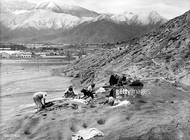 Tibetans proceed to 'Heavenly Funeral' in Lhasa Tibet in the 1980s During the traditional funeral the bodies are skinned after which flesh and bones...