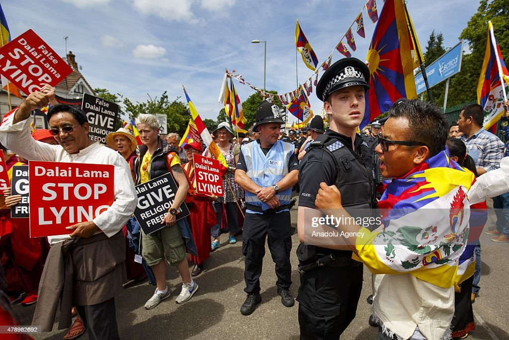 Tibetans support 14th Dalai Lama as the People gather to protest the spiritual leader of the Tibetan people 14th Dalai Lama accused with pursuing...
