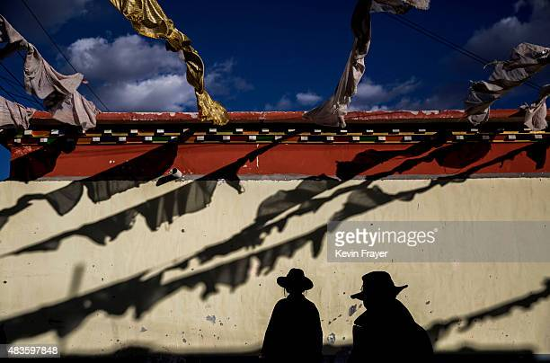 Tibetans work in a government resettlement community for former nomads on July 23 2015 on the Tibetan Plateau in Yushu County Qinghai China Tibetan...