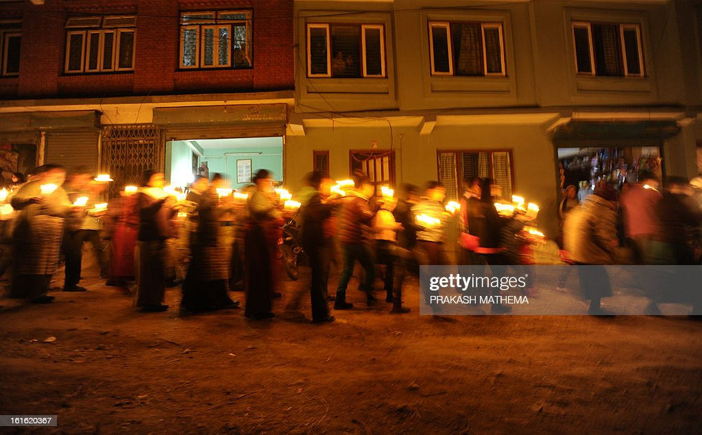 Tibetans-in-exile take part in a candlelight vigil following the self-immolation attempt by a monk earlier today, marking the one hundredth Tibetan to self immolate in protest against Chinese rule ...