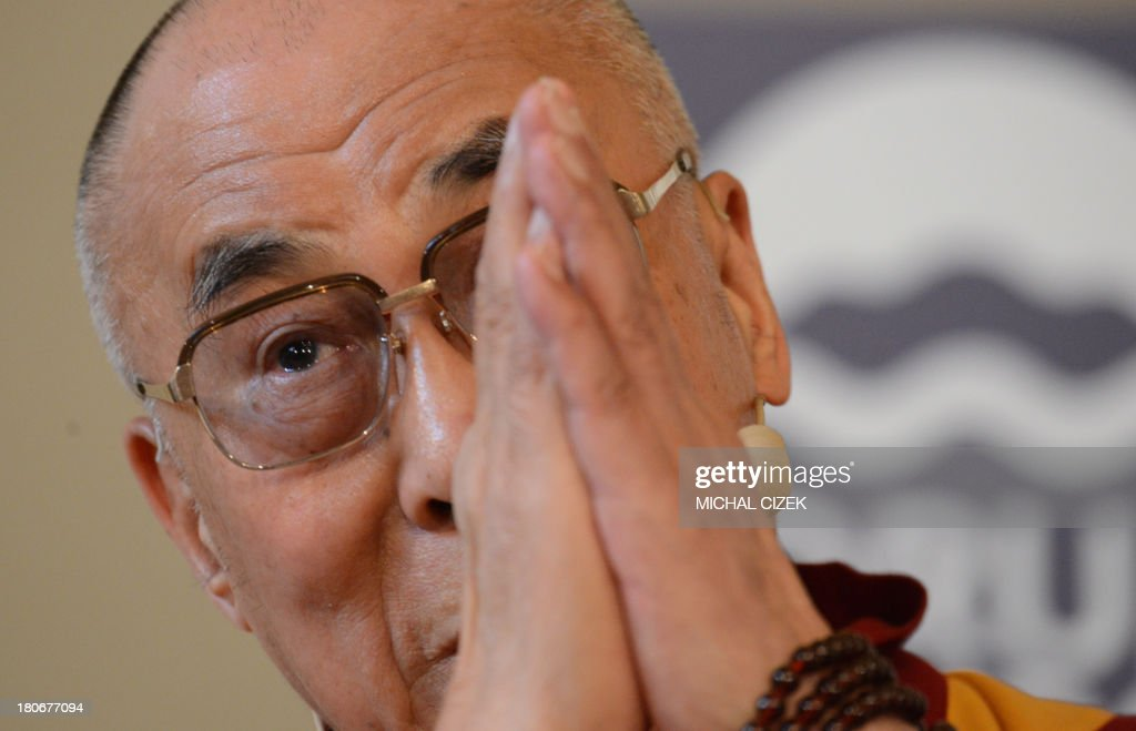 Tibet's exiled spiritual leader the Dalai Lama delivers a speech during the 17th Forum 2000 Conference focusing on societies and transition on September 16, 2013 in Prague. The annual forum was launched by the late Czech Velvet Revolution icon Vaclav Havel and American Holocaust survivor Elie Wiesel in 1997.
